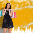 Composite image of woman walking with shopping bags — Stock Photo #57157003