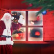 Composite image of santa claus ringing bell — Stock Photo #57157033
