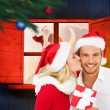 Composite image of young festive couple — Stock Photo #57157709