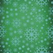 Snowflake pattern against green vignette — Stock Photo #57158349