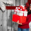 Composite image of woman holding many christmas presents — Foto Stock #57158945