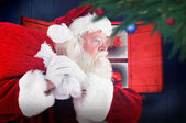 Composite image of santa claus carrying sack — Fotografia Stock
