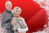 Composite image of mature winter couple — Stock Photo