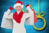 Composite image of festive woman holding shopping bags — Stock fotografie