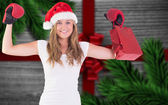 Composite image of festive blonde with boxing gloves and shoppin — Stock Photo