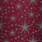 Snowflake pattern against red vignette — Stock Photo