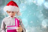 Immagine composita di festivo ragazzo che tiene un regalo — Foto Stock