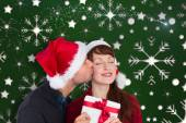 Couple holding a christmas gift — Stock Photo