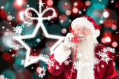 Composite image of santa claus on the phone — Stock Photo