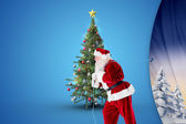 Composite image of santa claus pulling rope — Stock Photo