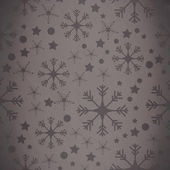 Snowflake pattern against grey vignette — Stock Photo