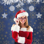 Composite image of sexy santa girl wearing spectacles — Stock Photo