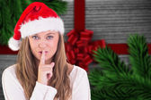 Composite image of festive blonde keeping a secret — Stok fotoğraf