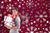 Man holding some large presents — Stock Photo