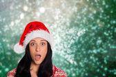 Composite image of woman surprised at the camera — Stock Photo