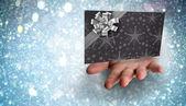 Composite image of hand bursting through paper — Stock Photo