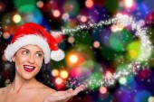 Composite image of woman wearing santa hat — Stok fotoğraf