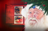 Composite image of santa claus winking — ストック写真