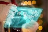 Composite image of santa using futuristic touchscreen — ストック写真