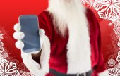Composite image of santa claus showing smartphone — Stock Photo