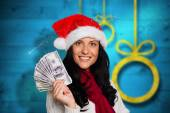 Composite image of woman holding some money — Stock Photo