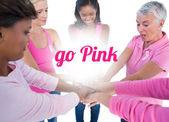 Women wearing pink and ribbons for breast cancer — Stockfoto