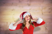 Composite image of sexy santa girl listening to music — Fotografia Stock