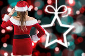 Santa girl with hand on hip — Stock Photo