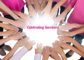 Hands joined in circle wearing pink for breast cancer — Stock Photo