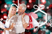 Happy couple with shopping bags and tablet pc — Fotografia Stock