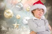 Composite image of festive boy sulking — Stock Photo