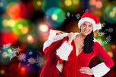 Composite image of woman smiling with christmas presents — Stok fotoğraf