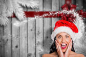 Composite image of surprised woman wearing santa hat — Stok fotoğraf