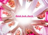 Diverse women smiling in circle wearing pink for breast cancer — Stock Photo