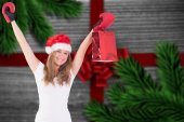 Composite image of festive blonde with boxing gloves and shoppin — Fotografia Stock