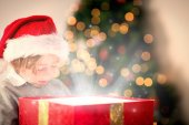 Composite image of child opening his christmas present — Stok fotoğraf