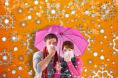 Composite image of couple standing underneath an umbrella — Foto Stock