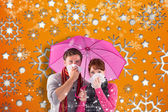 Composite image of couple standing underneath an umbrella — Zdjęcie stockowe