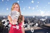 Composite image of pretty blonde showing wad of cash — Stock Photo