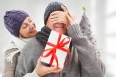 Mature woman surprising partner with gift — Stock Photo