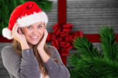 Composite image of festive blonde smiling at camera — Stok fotoğraf