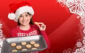 Festive little girl offering cookies — Stock Photo