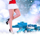 Composite image of festive womans legs in high heels — Стоковое фото