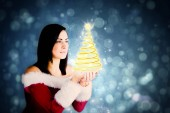 Girl in santa outfit with hands out — Stock Photo