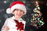 Composite image of festive boy showing letter — Foto Stock