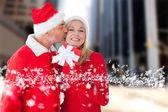 Composite image of festive couple — Stock Photo