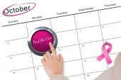 Hand pushing pink button for breast cancer awareness — Stock Photo