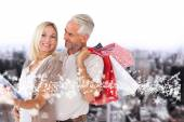 Happy couple with shopping bags and tablet pc — Stock Photo