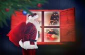 Composite image of santa claus carrying sack — Stok fotoğraf