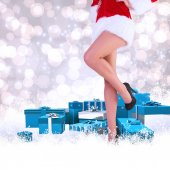 Composite image of festive womans legs in high heels — Stock Photo
